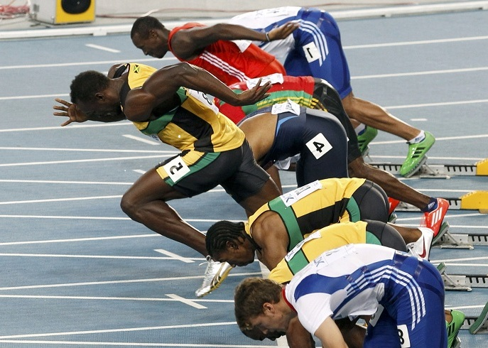 usain_bolt_of_jamaica_makes_a_false_start_during_t_4e5a9d64a8.jpg