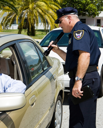 a-policeman-checking-drivers-license.jpg