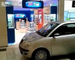 Security guards try to block a man entered with a car into a shopping mal
