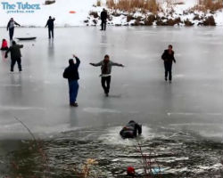 Dozen people rescued after falling into frozen lake trying to rescue man