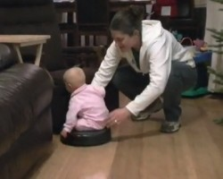 Baby Takes a Ride on a Roomba